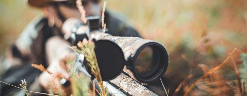 closeup-hunter-aiming-rifle